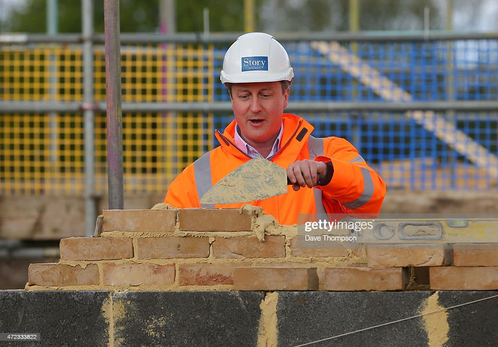 Prime Minister David Cameron finishes laying a brick during a visit to Story Homes Help to Buy development site on May 6, 2015 in Lancaster, England. Britain's political leaders are campaigning in a final day's push for votes ahead of what is predicted to be the closest General Election for a generation.