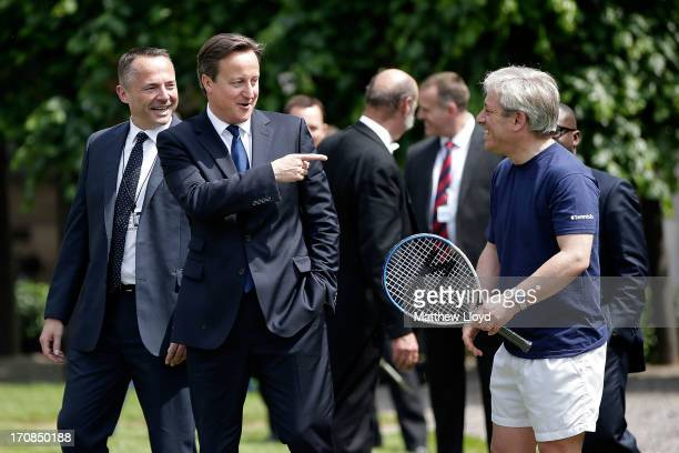 Prime Minister David Cameron gestures to the Speaker John Bercow at the LTA's #TennisIS event in the grounds of the Houses of Parliament on June 19...