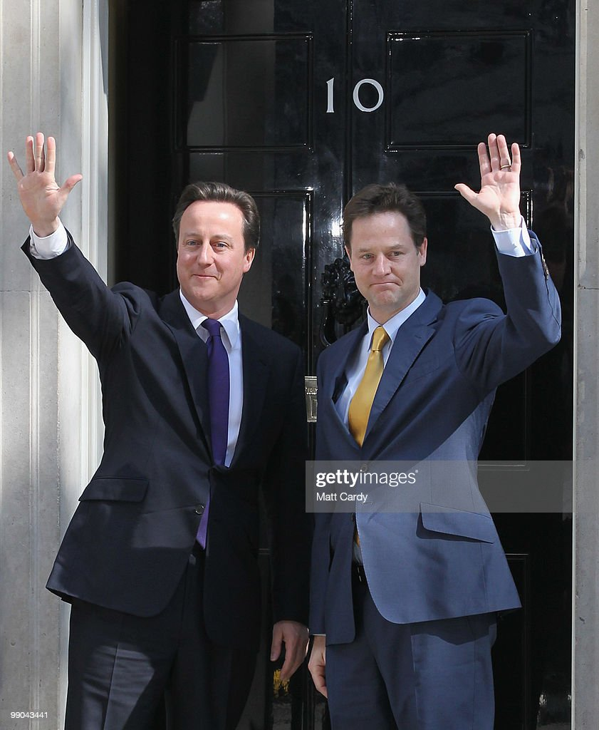 Prime Minister David Cameron greets Deputy Prime Minister Nick Clegg at the door of No. 10 Downing Street on May 12, 2010 in London, England. After a tightly contested election campaign and five days of negotiation a Conservative and Liberal Democrat coalition government has been confirmed.