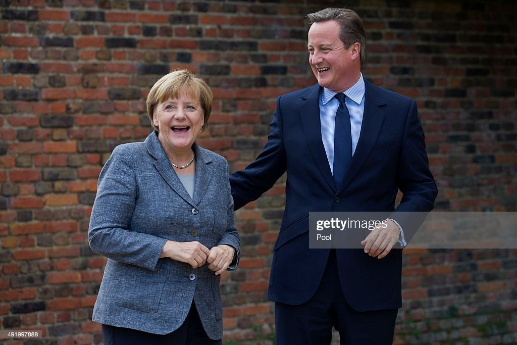 Prime Minister David Cameron (R) greets German Chancellor Angela Merkel (L) as he meets with her at Chequers, the Prime Minister's country residence on October 9, 2015 near Aylesbury, Buckinghamshire, United Kingdom. The meeting between the two leaders is expected to focus on Britain's EU renegotiation aims.