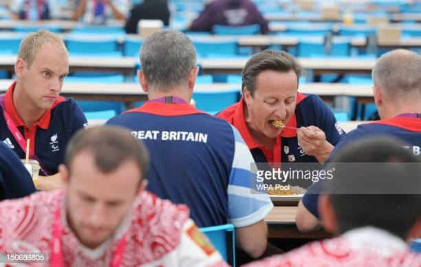 Prime Minister David Cameron has lunch with members of the Great Britain Paralympics football team during a visit to the Olympic village, ahead of...