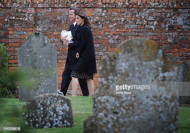 Prime Minister David Cameron his wife Samantha and their baby daughter Florence arrive at St Barnabas Church for the funeral of his father Ian who...
