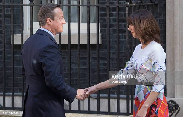 Prime Minister David Cameron holds his wife Samantha's hand after resigning on the steps of 10 Downing Street on June 24 2016 in London England The...