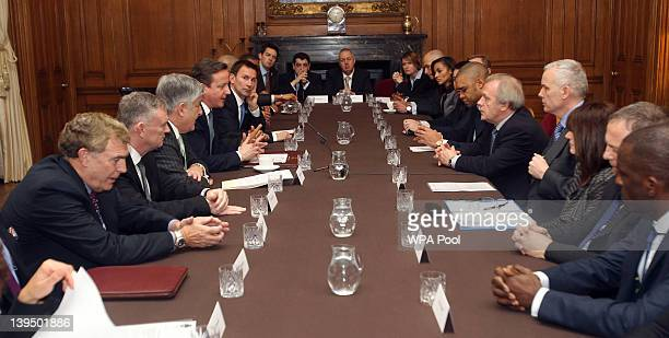 Prime Minister David Cameron hosts a roundtable antidiscrimination summit with former players and football bosses at Downing Street on February 22...
