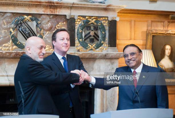 Prime Minister David Cameron hosts a trilateral meeting with President Hamid Karzai of Afghanistan and President Asif Ali Zardari of Pakistan at the...