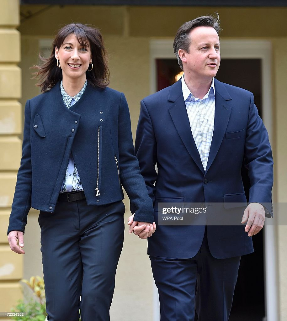 Prime Minister David Cameron (R) is joined by his wife Samantha (L) during a campaign visit to a home building scheme on May 6, 2015 in Lancaster, United Kingdom. Britain's political leaders are campaigning in a final day's push for votes ahead of what is predicted to be the closest General Election for a generation.