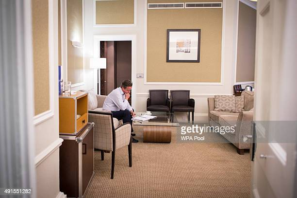 Prime Minister David Cameron is pictured in his hotel room as he prepares his conference speech that he will deliver to his party's annual conference...