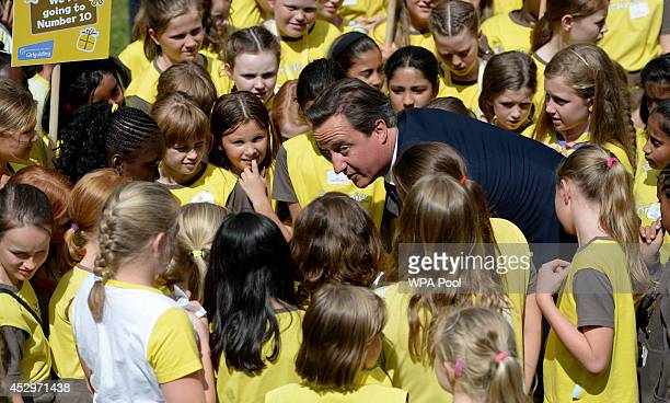 Prime Minister David Cameron is seen with young Brownies during a reception to celebrate the centenary of the Brownies at Downing Street on July 31...
