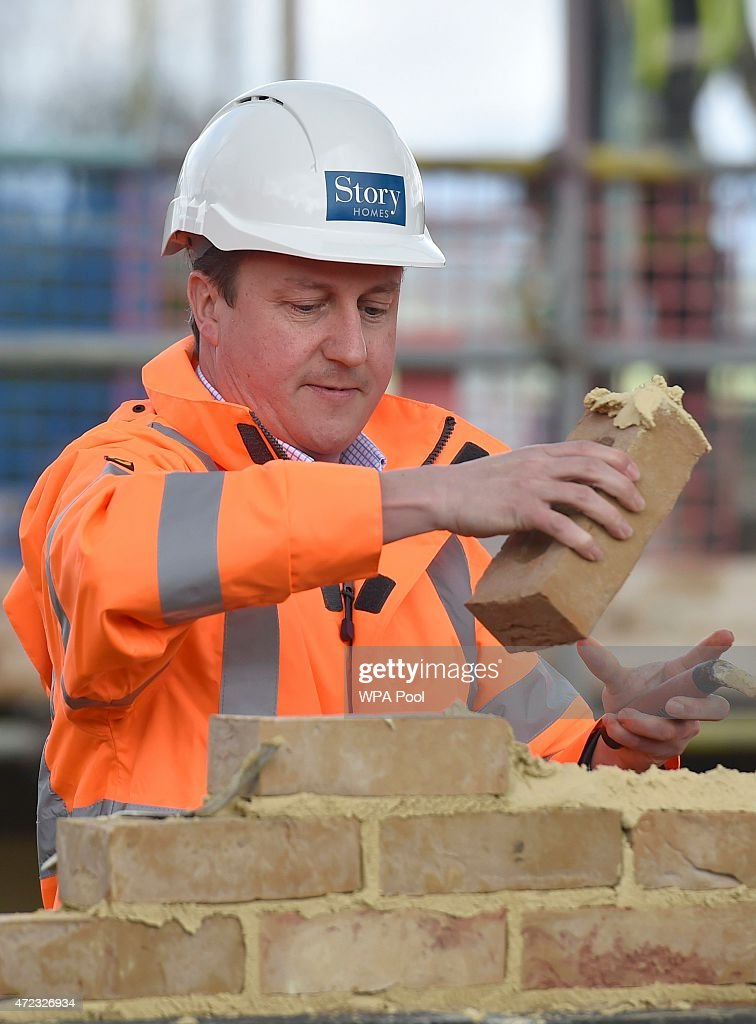 Prime Minister David Cameron lays a brick during a campaign visit to a home building scheme on May 6, 2015 in Lancaster, United Kingdom. Britain's political leaders are campaigning in a final day's push for votes ahead of what is predicted to be the closest General Election for a generation.