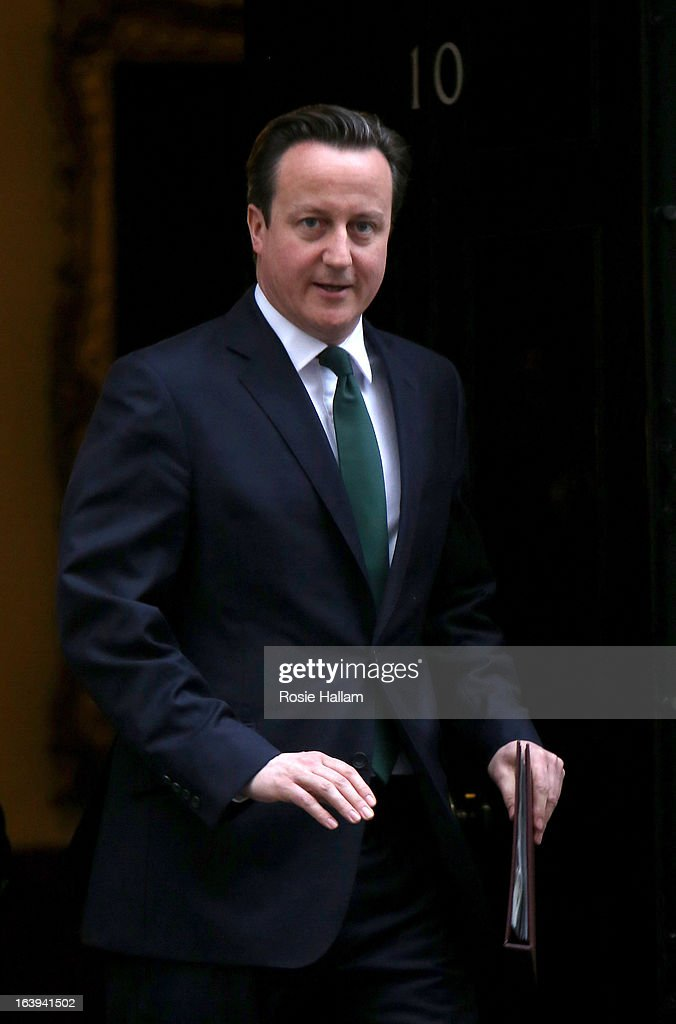 Prime Minister David Cameron leaves Downing Street for the Houses of Parliament on March 18, 2013 in London, England. A Press regulation deal has been agreed today by Conservatives, Labour and Lib Dems following a call for reform in the wake of Lord Justice Leveson's inquiry into press ethics and phone hacking.