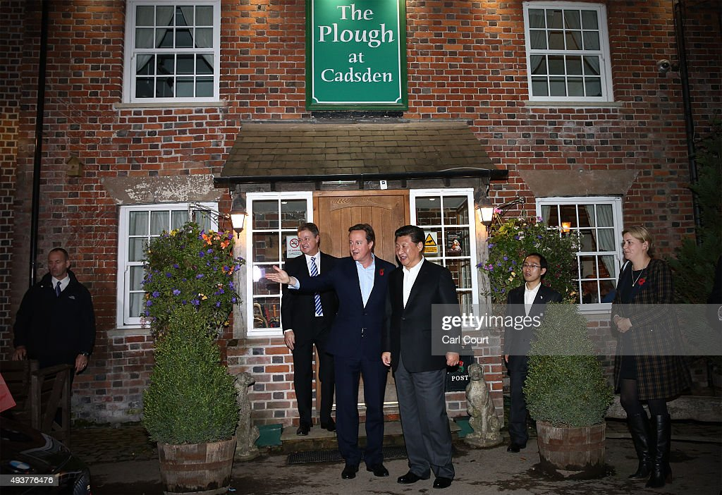 Prime Minister David Cameron leaves The Plough pub with China's president Xi Jinping on October 22, 2015 in Princes Risborough, England. The President of the People's Republic of China, Mr Xi Jinping and his wife, Madame Peng Liyuan, are paying a State Visit to the United Kingdom as guests of The Queen. They will stay at Buckingham Palace and undertake engagements in London and Manchester. The last state visit paid by a Chinese President to the UK was Hu Jintao in 2005.