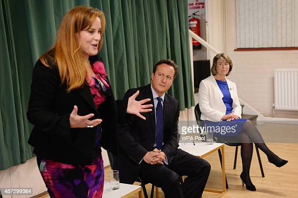 Prime Minister David Cameron listens to councillor Kelly Tolhurst after introducing her and Anna Firth as the Conservative Party's two applicants for...