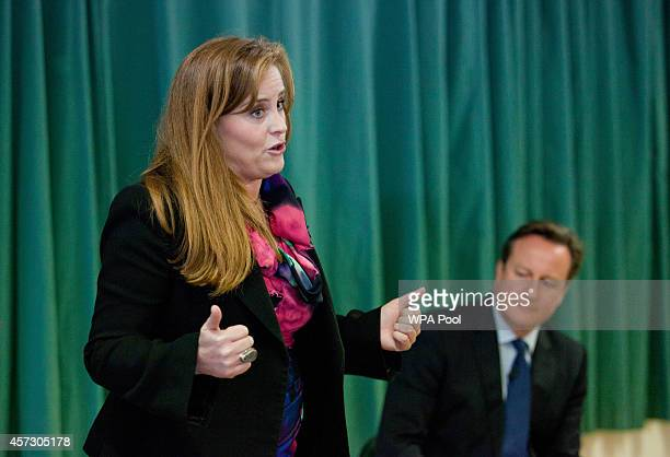 Prime Minister David Cameron listens to one of the Conservative Party's two applicants councillor Kelly Tolhurst as she speaks ahead of her...