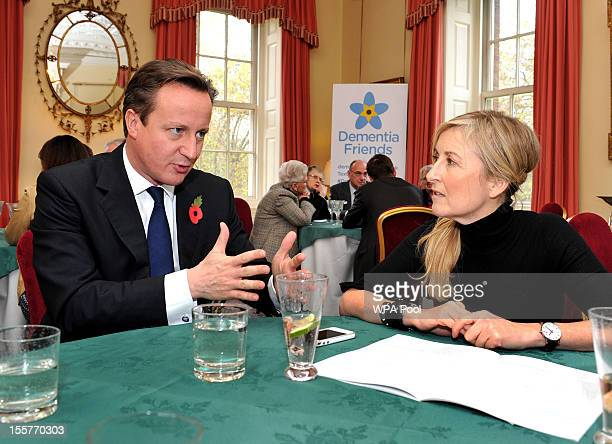 Prime Minister David Cameron listens to TV presenter Fiona Phillips during a reception for elderly sufferers of Dementia launching an ambitious plan...