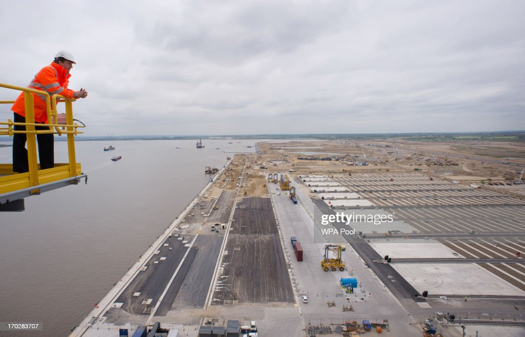 Prime Minister David Cameron looks over the River Thames estuary from the top of a 138m high quay crane on June 10, 2013 near Tilbury in Essex, England. The new development will be the United Kingdom's first deep sea container port and Europe's largest logistics park.