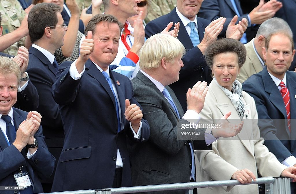 Prime Minister David Cameron, Mayor of London Boris Johnson, Princess Anne, Princess Royal and Prince Edward, Earl of Wessex cheer on the athletes as they take part in the London 2012 Victory Parade for Team GB and Paralympic GB athletes on September 10, 2012 in London, England.