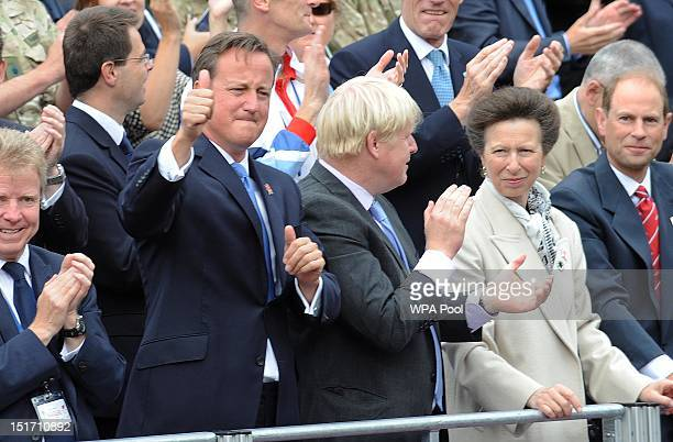 Prime Minister David Cameron Mayor of London Boris Johnson Princess Anne Princess Royal and Prince Edward Earl of Wessex cheer on the athletes as...