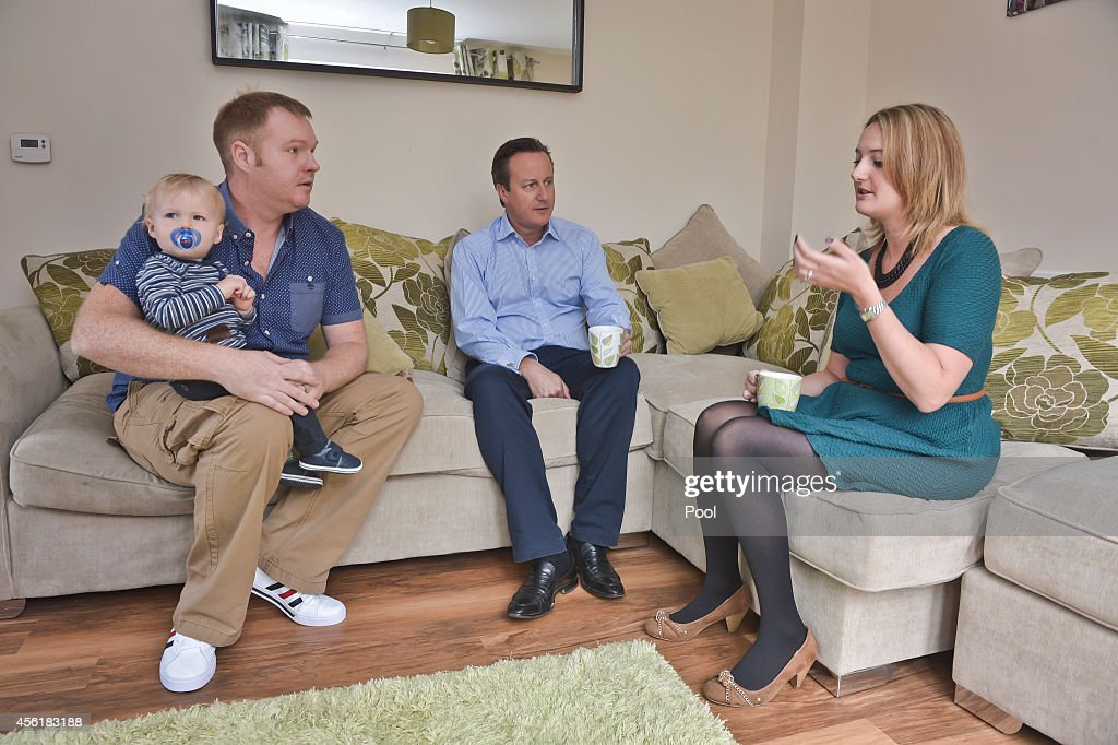Prime Minister David Cameron meets Barry and Samantha McBeth and their one year old Alfie during a visit to the new Taylor Wimpy Great Western Park housing estate on September 27 in Didcot, Oxfordshire, England. The Prime Minister makes a visit to Didcot ahead of the start of the Conservative Party Conference.