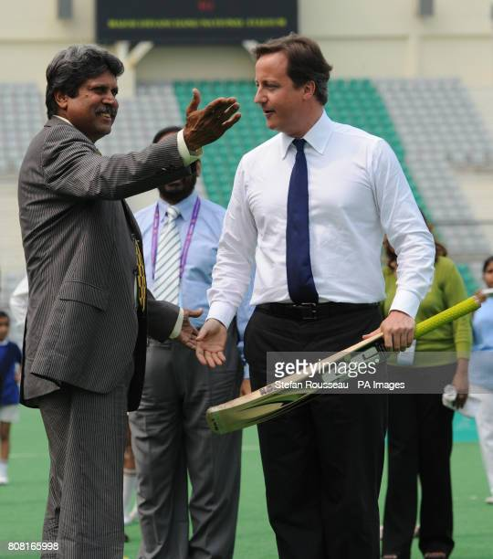 Prime Minister David Cameron meets former India cricketer Kapil Dev after playing cricket with school children from local schools in Dehli at the...