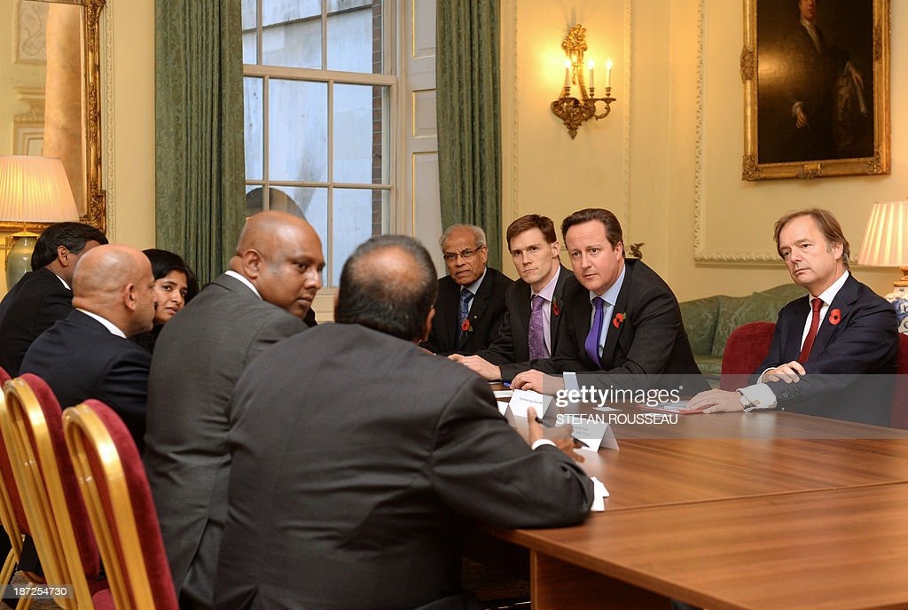 Prime Minister David Cameron meets leaders of the Tamil community in the UK at 10 Downing Street in London on November 7, 2013, ahead of his visit to Sri Lanka for next week's Commonwealth Heads of Government Meeting.
