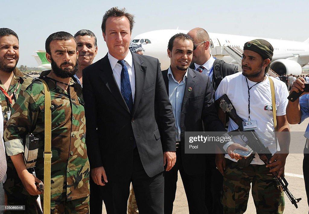 British Prime Minister David Cameron And French President Nicolas Sarkozy Visit Libya : News Photo