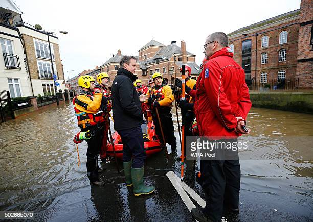Prime Minister David Cameron meets rescue teams working on flood relief in York city centre after the river Ouse burst its banks on December 28 2015...