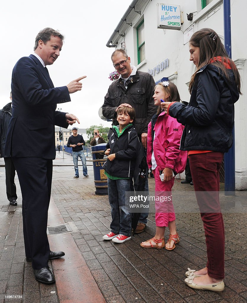Prime Minister David Cameron meets shoppers in Coleraine High Street , during a visit to the region on August 01, 2012 in Coleraine, Northern Irland. During his time in Coleraine, Cameron visited the home club of one of the top British rowers, Alan Campbell, just ahead of his next stage in the Olympics semi-final race.