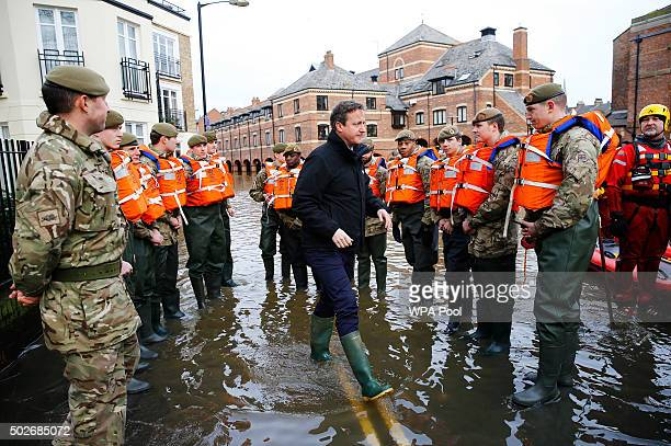 Prime Minister David Cameron meets soldiers working on flood relief in York city centre after the river Ouse burst its banks on December 28 2015 in...