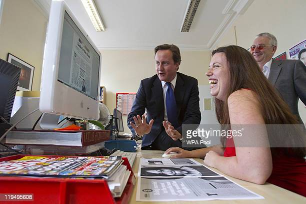 Prime Minister David Cameron meets with staff of 'The Big Issue' magazine as he guest edits this week's edition on July 21 2011 in South London...