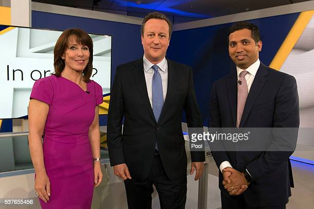 Prime Minister David Cameron poses for a photograph with Faisal Islam and Kay Burley after attending a Sky News interview and Q and A session where...