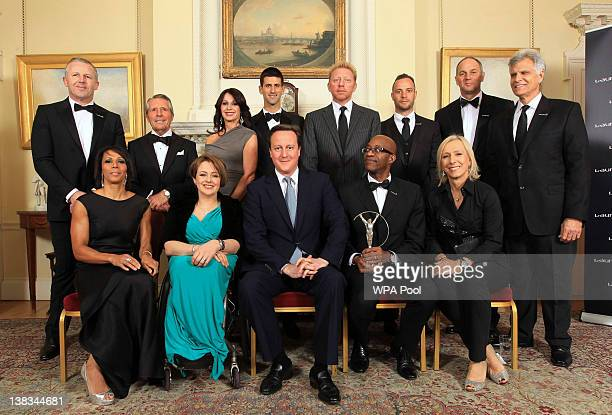 Prime Minister David Cameron poses for a photograph with sports personalities Sean Fitzpatrick Gary Player Nadia Comaneci Novak Djokovic Boris Becker...