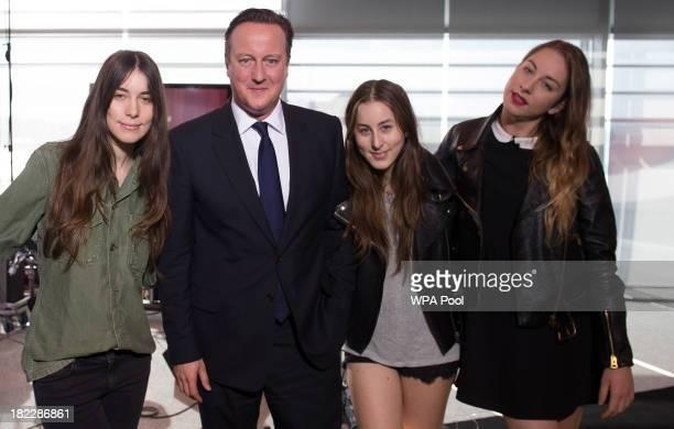 Prime Minister David Cameron poses with Este Haim Danielle Haim and Alana Haim of the rock group Haim as they appear on the BBC current affairs...