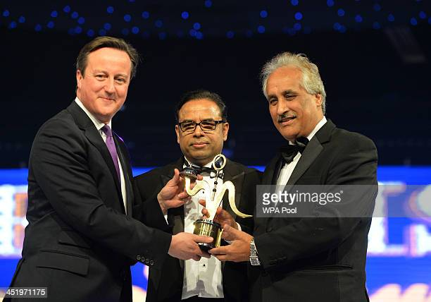 Prime Minister David Cameron presents an award at the British curry awards at Battersea Evolution on November 25 2013 in London England