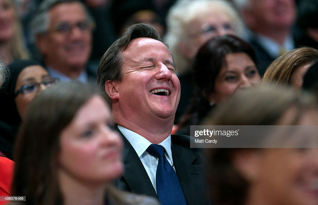 Prime Minister David Cameron reacts as Mayor of London Boris Johnson addresses the Conservative Party Conference in the main hall of the ICC Birmingham on on September 30, 2014 in Birmingham, England. The third day of conference will see speeches on home affairs and justice.