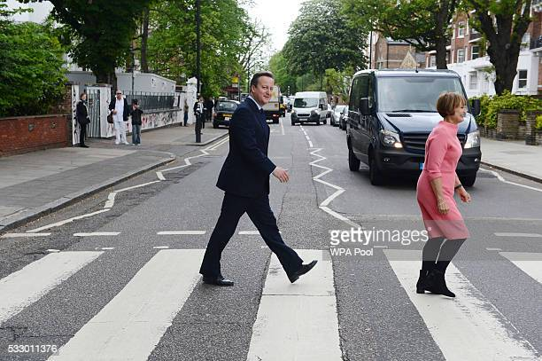 Prime Minister David Cameron recreates the famous Beatles Abbey Road album cover by walking across Abbey Road crossing with Tessa Jowell former...