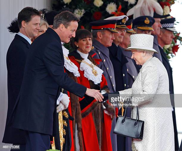 Prime Minister David Cameron shakes hands with Queen Elizabeth II as they attend the Ceremonial Welcome for Mexican President Enrique Pena Nieto at...