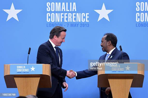 Prime Minister David Cameron shakes hands with Somali President Hassan Sheikh Mohamud during a press conference at the Foreign and Commonwealth...