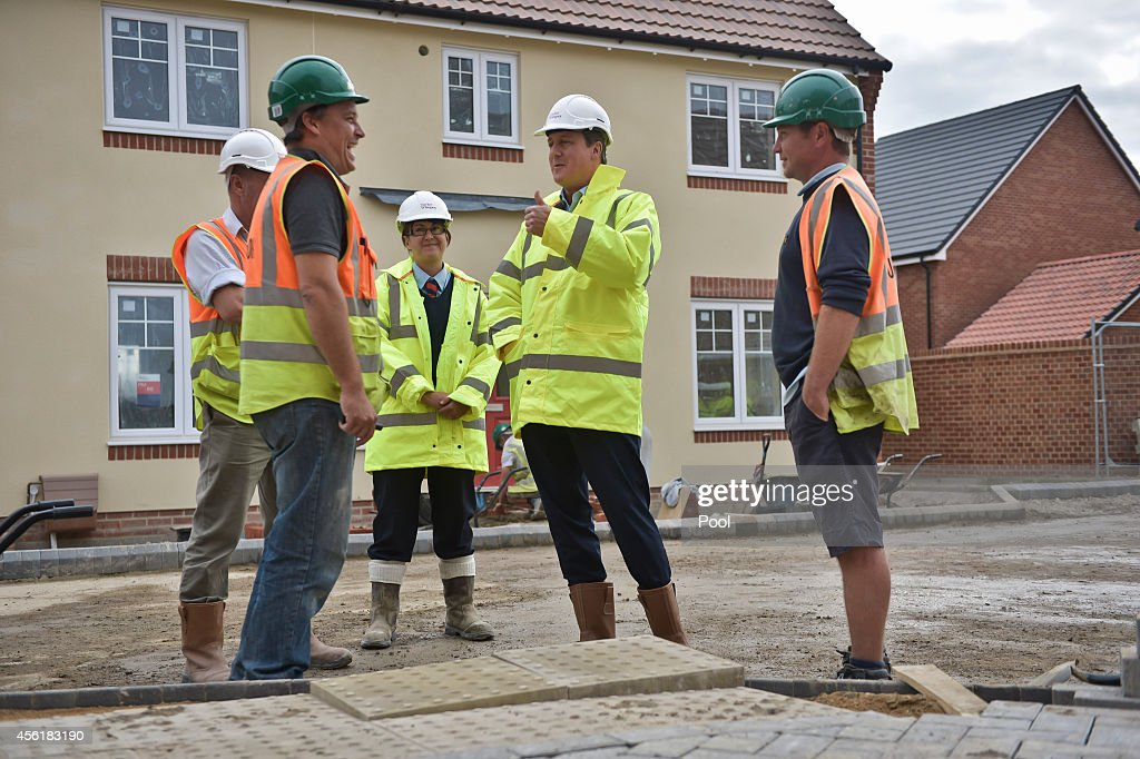 Prime Minister David Cameron shares a joke with builders during a visit to the new Taylor Wimpy Great Western Park housing estate on September 27 in Didcot, Oxfordshire, England. The Prime Minister makes a visit to Didcot ahead of the start of the Conservative Party Conference.