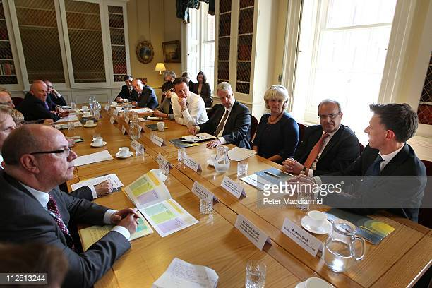 Prime Minister David Cameron sits next to Health Secretary Andrew Lansley at 10 Downing Street during a meeting with health professionals on April 19...