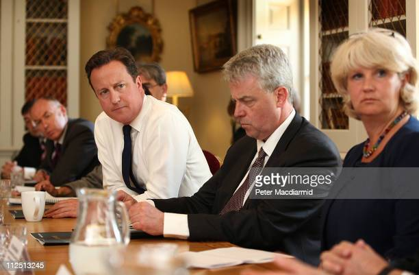 Prime Minister David Cameron sits next to Health Secretary Andrew Lansley and Clare Murdoch of the Central and North West London Mental Health Trust...