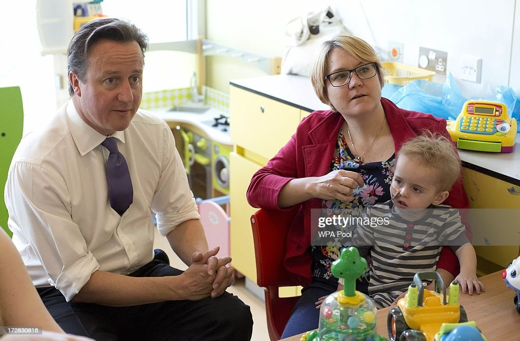 Prime Minister David Cameron sits with Alex Mulford and his mother Mary during his visit to the Evelina London Children's Hospital on July 5, 2013 in London, England. Cameron visited the hospital on Friday to mark the 65th anniversary of the National Health Service (NHS).