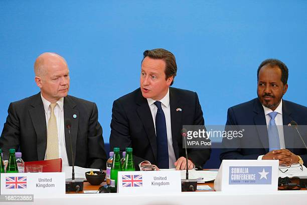 Prime Minister David Cameron sits with Foreign Secretary William Hague and Somali President Hassan Sheikh Mohamud during the Somali conference on May...