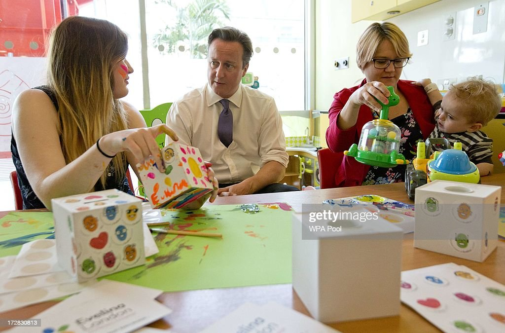 Prime Minister David Cameron sits with patients Kitty O'leary (L) and Alex Mulford (R) and his mother Mary during his visit to the Evelina London Children's Hospital on July 5, 2013 in London, England. Cameron visited the hospital on Friday to mark the 65th anniversary of the National Health Service (NHS).