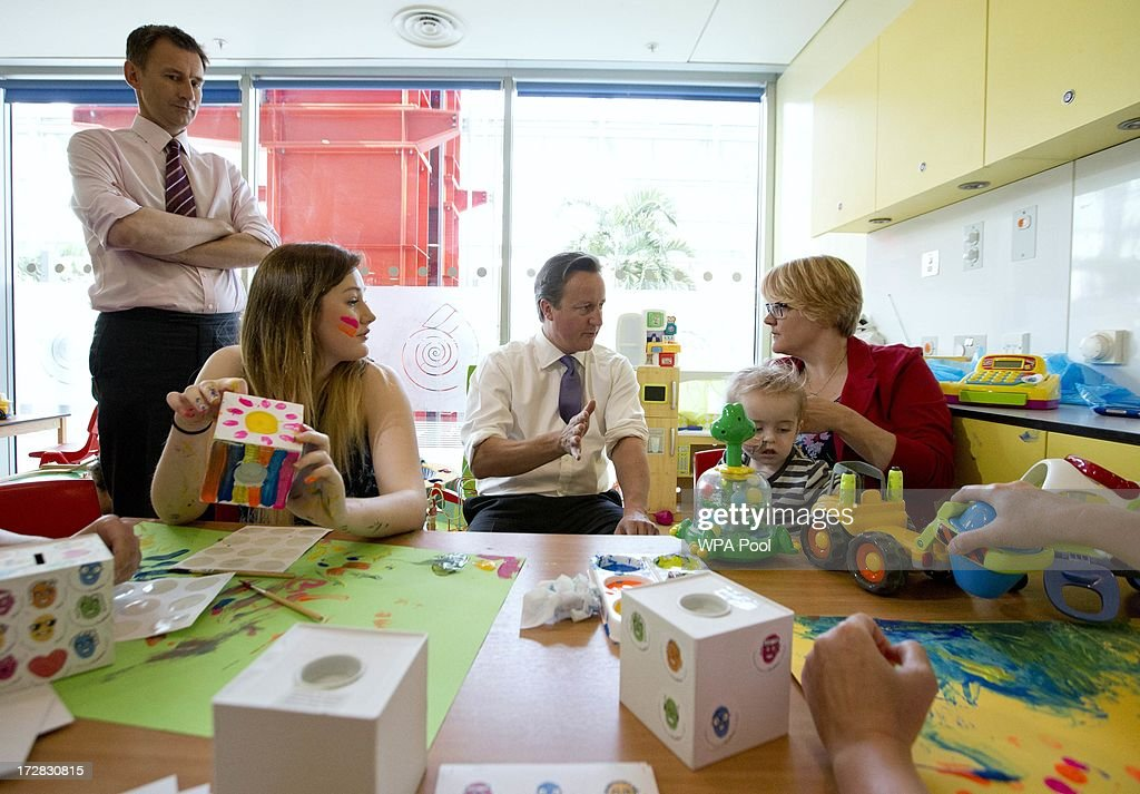 Prime Minister David Cameron sits with patients Kitty O'leary (2L) and Alex Mulford (2R) and his mother Mary as Health Secretary Jeremy Hunt (L) looks on during his visit to the Evelina London Children's Hospital on July 5, 2013 in London, England. Cameron visited the hospital on Friday to mark the 65th anniversary of the National Health Service (NHS).