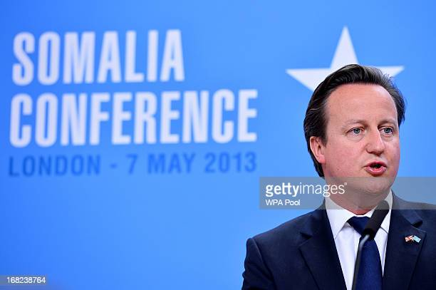 Prime Minister David Cameron speaks alongside Somali President Hassan Sheikh Mohamud during a press conference at the Foreign and Commonwealth Office...