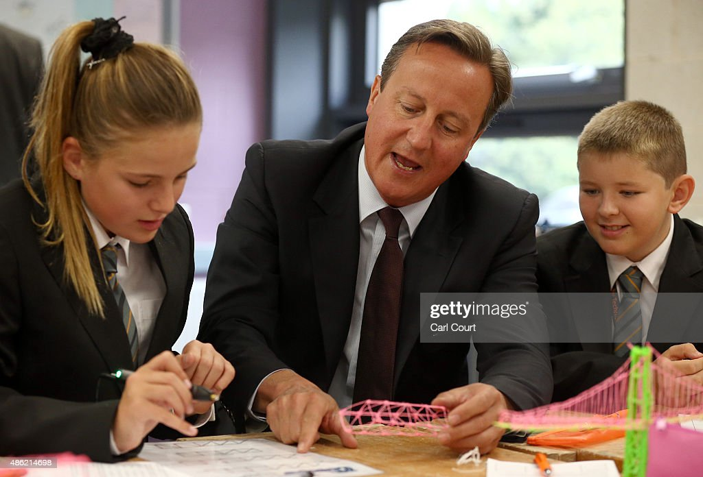 Prime Minister David Cameron speaks to pupils during a visit to Corby Technical School on September 2, 2015 in Corby, England. Mr Cameron used the visit to announce plans for another 18 free schools in England.