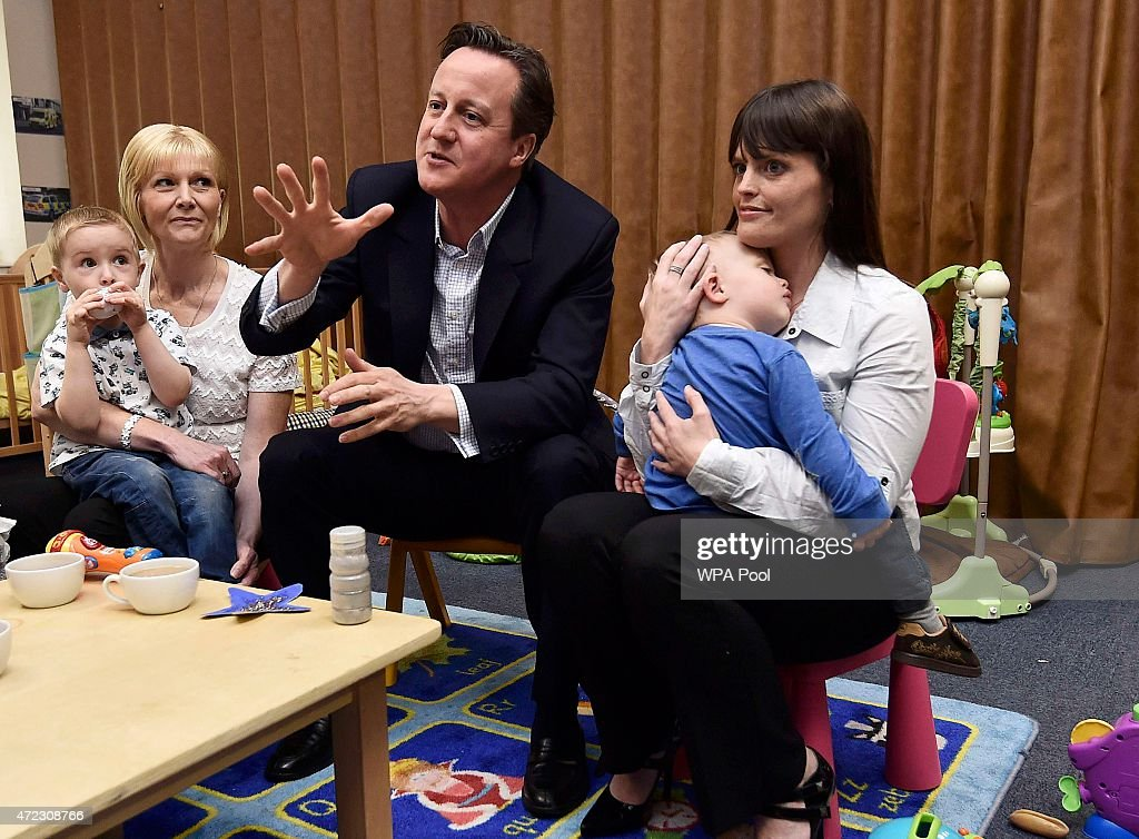 Prime Minister David Cameron speaks with parents during a campaign visit to a nursery on May 6, 2015 in Cannock, United Kingdom. Britain's political leaders are campaigning in a final day's push for votes ahead of what is predicted to be the closest General Election for a generation.