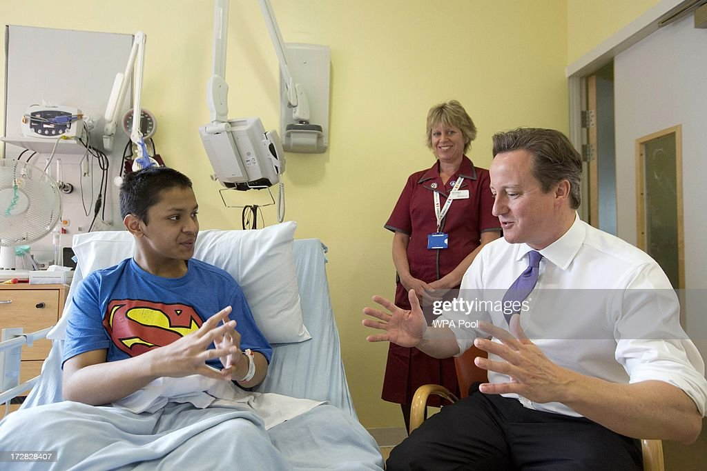 Prime Minister David Cameron speaks with patient Liam Islam during his visit to the Evelina London Children's Hospital on July 5, 2013 in London, England. Cameron visited the hospital on Friday to mark the 65th anniversary of the National Health Service (NHS).