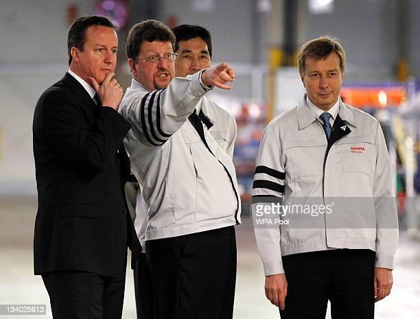 Prime Minister David Cameron speaks with Toyota UK Deputy Managing Director Tony Walker at a Toyota plant on November 24 2011 in Burnaston United...