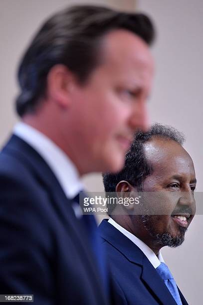 Prime Minister David Cameron stands alongside Somali President Hassan Sheikh Mohamud during a press conference at the Foreign and Commonwealth Office...